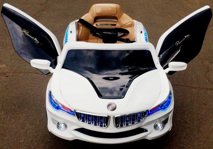 Детский электромобиль Rivertoys BMW O 002 OO VIP белый сиденье кожа